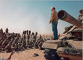 Speaking from the front of an M-60 battle tank, United States Secretary of Defense Dick Cheney addresses U.S. Marines deployed in the eastern Saudi Arabian desert as part of Operation DESERT SHIELD on December 22, 1990.<br /> Mandatory Credit: James Kudla / U.S. Navy via CNP