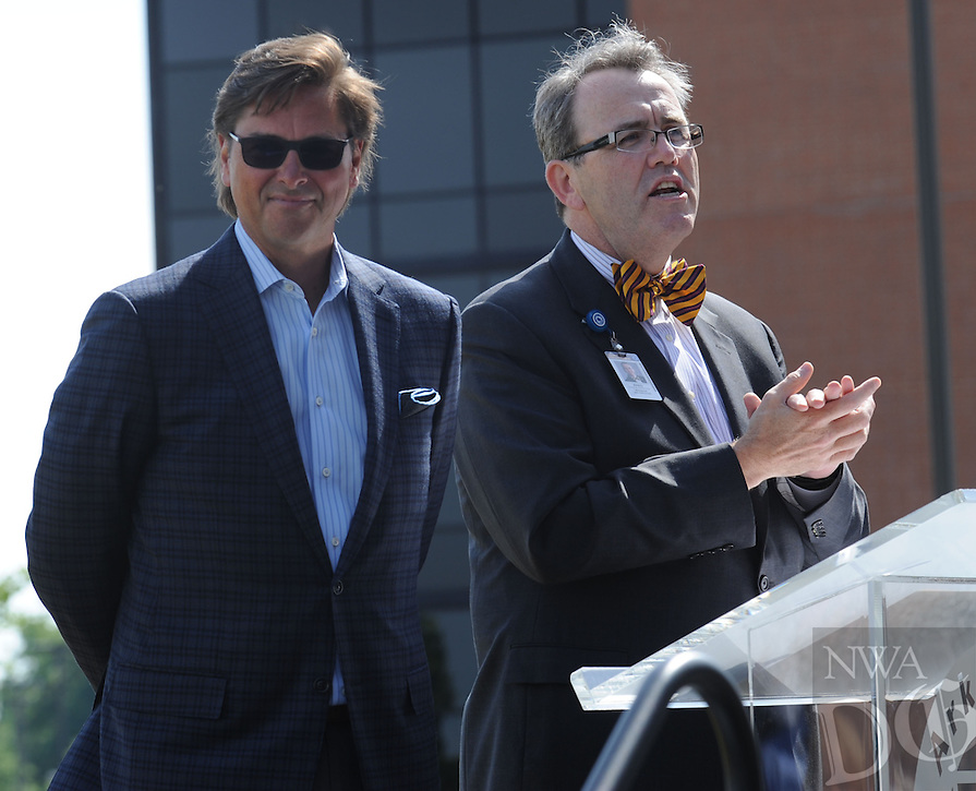 NWA Democrat-Gazette/ANDY SHUPE<br /> Fred Scarborough (right), president of the Arkansas Children's Hospital Foundation, speaks Thursday, May 19, 2016, alongside John Roberts, president and CEO of J.B. Hunt Transport, during an announcement of a $5 million gift from J.B. Hunt Transport to Arkansas Children's Hospital for the construction of its planned Northwest Arkansas campus at the J.B. Hunt corporate offices in Lowell.