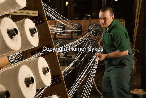 Mark Smith is Ropier at The Historic Dockyard Chatham Kent. Mark is using two hundred year old machinery  and seen here with 18 mm rope thats coming off 'cops' ( bobbins), before being fed through the registration plates and then 'forming tubes' to become 2.25 inch diameter rope.