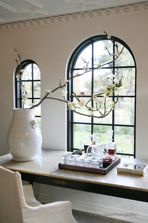 A french antique table sits up against the arched windows in the front of the living room. We visit the owners of Aera, John Moinzad and David Hintgen.