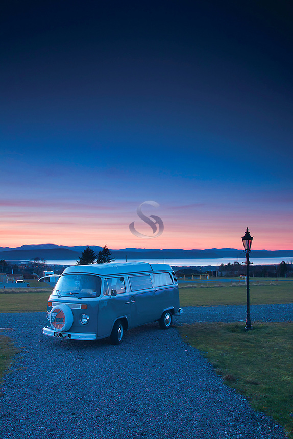 A VW Campervan at sunset, overlooking the Moray Firth and Beauly Firth, Inverness, Highlands