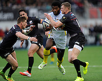 Noa Nakaitaci of ASM Clermont Auvergne is tackled by Chris Ashton of Saracens during the European Rugby Champions Cup  Round 1 match between Saracens and ASM Clermont Auvergne at the Twickenham Stoop on Saturday 18th October 2014 (Photo by Rob Munro)