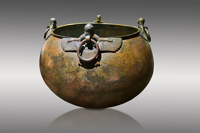 Phrygian bronze couldron with decorated winged figure handles . From Gordion. Phrygian Collection, 8th century BC - Museum of Anatolian Civilisations Ankara. Turkey.