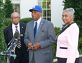 Negro Baseball League players Ron Teasley, left, Pedro Sierra, center, and Minnie Forbes of the Detroit Stars, the last living owner of a team in the Negro Leagues, right, at the White House in Washington, D.C. on Monday, August 5, 2013 following their meeting with United States President Barack Obama.<br /> Credit: Ron Sachs / CNP<br /> (RESTRICTION: NO New York or New Jersey Newspapers or newspapers within a 75 mile radius of New York City)