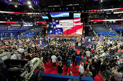 "Delegates await the arrival of Chairman of the Republican National Committee Reince Priebus to convene the opening session of the 2012 Republican National Convention in Tampa Bay, Florida on Monday, August 27, 2012.  Due to the effects of Hurricane Isaac, it was immediately recessed ""subject to the call of the chair""..Credit: Ron Sachs / CNP.(RESTRICTION: NO New York or New Jersey Newspapers or newspapers within a 75 mile radius of New York City)"