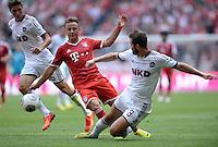Fussball  1. Bundesliga  Saison 2013/2014  3. Spieltag FC Bayern Muenchen - 1. FC Nuernberg       24.08.2013 Mario Goetze (Mitte, FC Bayern Muenchen) gegen Per Nilsson (re, 1. FC Nuernberg) und Niklas Stark (li, 1. FC Nuernberg)