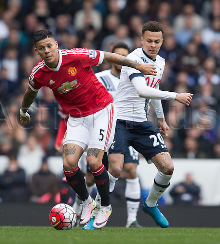 10.04.2016. White Hart Lane, London, England. Barclays Premier League. Tottenham Hotspur versus Manchester United. Manchester United defender Marcos Rojo (5) and Tottenham Hotspur midfielder Dele Alli (20) battling for the ball