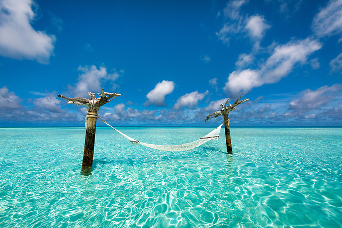 A relaxing escape... this hammock stands on a small sandbar in the lagoon waters of the Indian Ocean.<br />