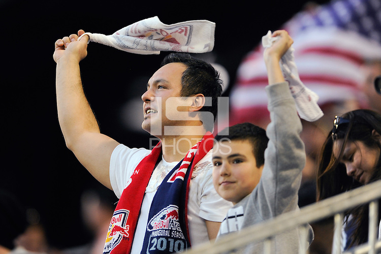 New York Red Bulls fans celebrate after the team scored a goal during the first half of a friendly between Santos FC and the New York Red Bulls at Red Bull Arena in Harrison, NJ, on March 20, 2010. The Red Bulls defeated Santos FC 3-1.