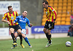 St Johnstone v Partick Thistle...29.03.14    SPFL<br /> Aaron Taylor-Sinclair is fouled by Lee Croft<br /> Picture by Graeme Hart.<br /> Copyright Perthshire Picture Agency<br /> Tel: 01738 623350  Mobile: 07990 594431