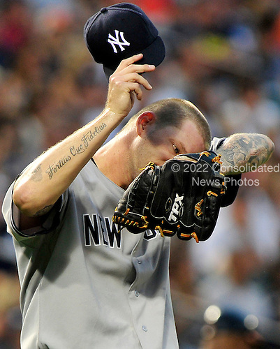 New York Yankees pitcher A.J. Burnett (34) wipes his brow in first inning action against the Baltimore Orioles at Oriole Park at Camden Yards in Baltimore, MD on Friday, August 26, 2011..Credit: Ron Sachs / CNP.(RESTRICTION: NO New York or New Jersey Newspapers or newspapers within a 75 mile radius of New York City)