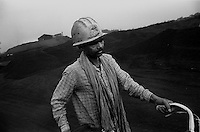 A miner with his cycle at the coal mining area in Jharia. Jharkhand, India. Arindam Mukherjee