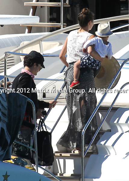 5 AUGUST 2012 ..HAMILTON ISLAND QUEENSLAND  AUSTRALIA..EXCLUSIVE..Miranda Kerr and husband Orlando Bloom board Bob Oatleys yacht 'Andiamo' at Hamilton Island. The couple are pictured with Flynn and appeared in good spirits as they set off to enjoy some family time on a cruise around the Whitsunday Islands. The Kerrblooms are staying at the exclusive Qualia Resort beach house. ...*No internet without clearance*.MUST CALL PRIOR TO USE ..+61 2 9211-1088.Matrix Media Group.Note: All editorial images subject to the following: For editorial use only. Additional clearance required for commercial, wireless, internet or promotional use.Images may not be altered or modified. Matrix Media Group makes no representations or warranties regarding names, trademarks or logos appearing in the images.