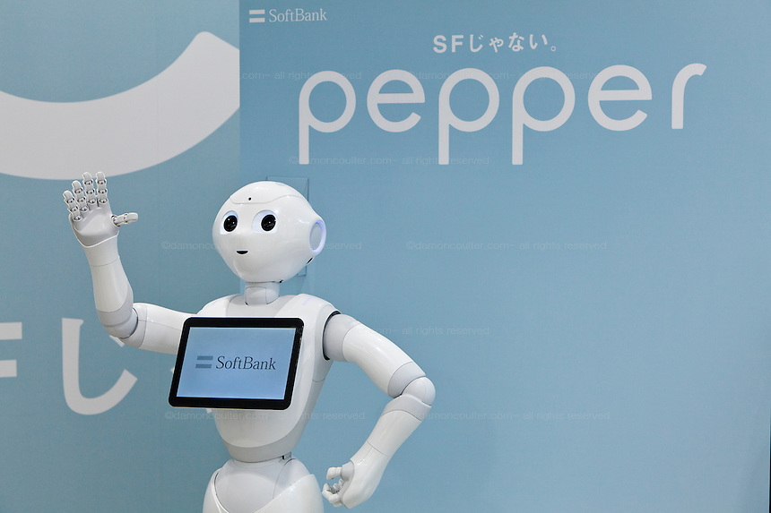 Softbank's emotional consumer Robot, Pepper on display at the Softbank Store Omotesandoi, Tokyo, Japan. Friday June 13th 2014. Standing 120cms tall the humanoid robot is able to recognize people and carry on a conversation. At this moment a marketing tool, the mobile phone compay, softbank plabs to sell the robots from 2015