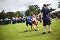 Men compete in the backhold wrestling event at the Inveraray Highland Games, held at Inveraray Castle in Argyll.