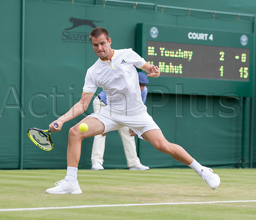 July 4th 2017, All England Lawn Tennis and Croquet Club, London, England; The Wimbledon Tennis Championships, Day 2; Mikhail Youzhny (RUS) hits a forehand return to Nicolas Mahut (FRA)