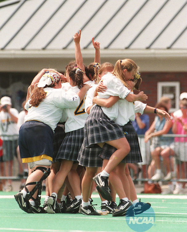 Caption:  The Trenton State Lions celebrate after winning the Division III Womenâ Lacrosse Championship May 21, 1995 in Trenton, New Jersey. Daniel Hulshizer/NCAA photos.