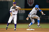 LSU Tiger shortstop Alex Bregman (30) and UCLA runner Kevin Williams (5) wait for the umpire to make a call at second base during Game 4 of the 2013 Men's College World Series against the UCLA Bruins on June 16, 2013 at TD Ameritrade Park in Omaha, Nebraska. UCLA defeated LSU 2-1. (Andrew Woolley/Four Seam Images)