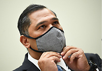 Brian Bulatao, Under Secretary of State for Management, adjusts his face mask as he testifies before a House Committee on Foreign Affairs hearing looking into the firing of State Department Inspector General Steven Linick, on Capitol Hill in Washington, D.C. on Wednesday, September 16, 2020. The foreign affairs committee issued the subpoenas as part of the panel's probe into accusations that Linick was fired while investigating Secretary of State Mike Pompeo's role in a controversial $8 billion weapons sale to Saudi Arabia. <br /> Credit: Kevin Dietsch / Pool via CNP /MediaPunch