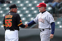 Lehigh Valley Ironpigs manager Ryne Sandberg #23 talks with Tom Nieto #55 during the first game of a double header against the Rochester Red Wings at Frontier Field on April 14, 2011 in Rochester, New York.  Rochester defeated Lehigh Valley with a walk off home run 3-1 in the bottom of the seventh.  Photo By Mike Janes/Four Seam Images