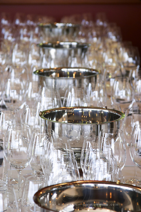 Table set for lunch and a big wine tasting, with many wine tasting glasses and shining silver spittoons Bodega Familia Schroeder Winery, also called Saurus, Neuquen, Patagonia, Argentina, South America