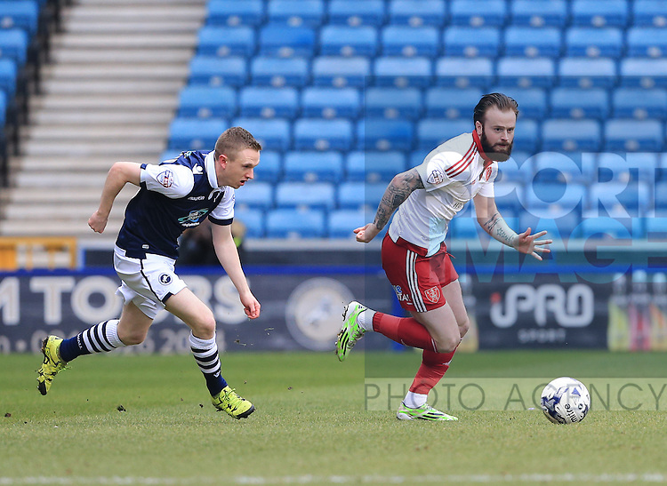 Millwall's Lee Gregory tussles with Sheffield United's John Brayford during the League One match at The Den.  Photo credit should read: David Klein/Sportimage