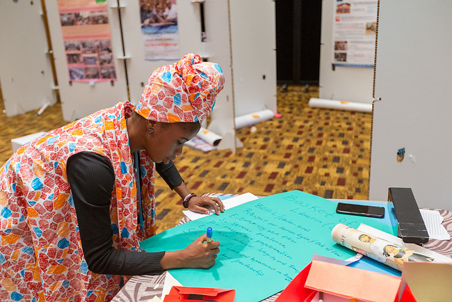 27 June, 2018, Kuala Lumpur, Malaysia : Massa F Kanneg of Liberia smoking a poster in the Village on the third day at the Girls Not Brides Global Meeting 2018 at the Kuala Lumpur Convention Centre. Picture by Graham Crouch/Girls Not Brides