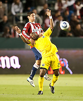 CARSON, CA – APRIL 9, 2011: Columbus Crew forward Emilio Renteria (20) is pulled down by Chivas USA defender Zarek Valentin.during the match between Chivas USA and Columbus Crew at the Home Depot Center, April 9, 2011 in Carson, California. Final score Chivas USA 0, Columbus Crew 0.