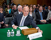 """Richard F. Smith, former Chairman and Chief Executive Officer, Equifax, Inc. arranges his name card prior to giving testimony before the United States Senate Committee on Banking, Housing, and Urban Affairs as they conduct a hearing entitled, """"An Examination of the Equifax Cybersecurity Breach"""" on Capitol Hill in Washington, DC on Tuesday, October 3, 2017. <br /> Credit: Ron Sachs / CNP"""