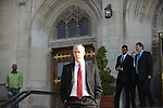 Former US Secretary of Education and Chicago Public Schools chief Arne Duncan exits the visitation of Tyshawn Lee, 9, who was shot multiple times while playing basketball in an alley on November 2, 2015, at St. Sabina's in Chicago, Illinois on November 10, 2015. Police allege the killing was a retaliatory gang hit which would mark a new turn in Chicago's gang wars.