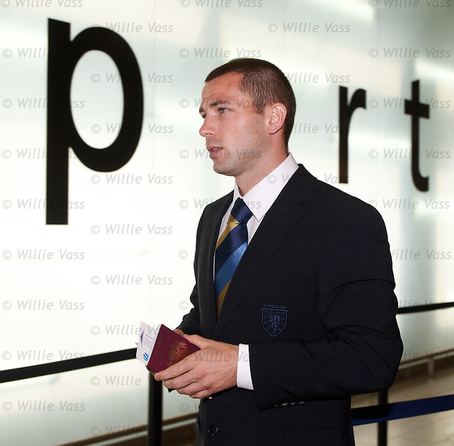New Scotland call-up Phil Bardsley looks the part with ticket in hand as he joins up with the squad to go to Prague