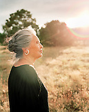 USA, New Mexico, beautiful Native American woman at sunset, Valley of the Wild Roses