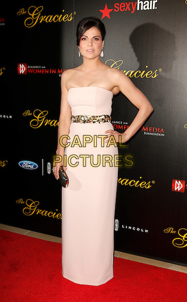 Lana Parilla.Gracie Awards Gala 2013 held at Beverly Hilton Hotel, Beverly Hills, California, USA..May 21st, 2013.full length pink white strapless dress gold belt cleavage too tight.CAP/ADM/ES.©Emiley Schweich/AdMedia/Capital Pictures