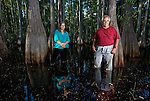 Anne and Jack Rudloe stand in the dark tannic waters of a cypress swamp on their property in Panacea, Florida May 10, 2009  (Mark Wallheiser/TallahasseeStock.com)