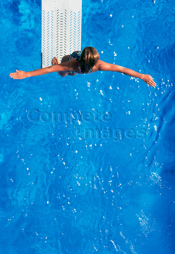 Woman standing on diving board