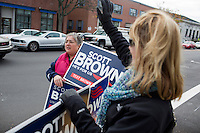 Supporters of Senator Scott Brown (R-MA) hold signs and wave to drivers on a street in Milford, Massachusetts, USA, on Thurs., Nov. 2, 2012. Senator Scott Brown is seeking re-election to the Senate.  His opponent is Elizabeth Warren, a democrat.