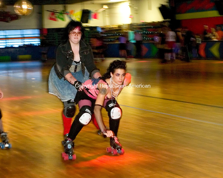WATERBURY, CT- 27 AUGUST 06- 082706JT03-<br /> Practicing a move used during roller derbies to assist teammates, Nichole Fisher aka Motley Crucial, of Waterbury, pushes Jillian Miller-Smulski aka Pepper, also of Waterbury, at Roller Magic roller rink in Waterbury on Sunday during an exhibition and fundraiser to get the CT Women's Roller Derby league started.<br /> Josalee Thrift Republican-American