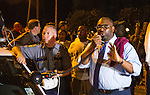 BATON ROUGE, LA -JULY 08:  Baton Rouge councilman Lamon Cole, right, appeals to the protesters for calm as they face off with Baton Rouge police about the Alton Sterling shooting in Baton Rouge, Louisiana July 8, 2016.  Sterling was shot and killed by police on July 5, 2016 in Baton Rouge, Louisiana. (Photo by Mark Wallheiser/Getty Images)