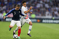 Lyon, France - Saturday June 09, 2018: ntoine Griezmann, Antonee Robinson during an international friendly match between the men's national teams of the United States (USA) and France (FRA) at Groupama Stadium.