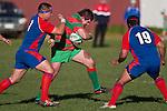 Gary Saifoloi & Suliasi Taufalele look to stop Grany Hensons run.  Counties Manukau Premier Club Rugby game between Waiuku & Ardmore Marist played at Waiuku on Saturday 20th June, 2009. Waiuku won the game 28 - 25.