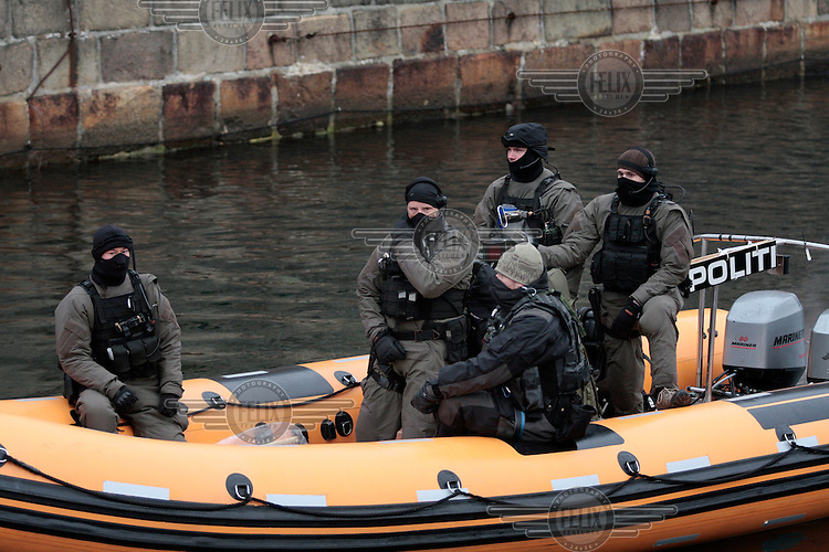 Special police in a boat during demonstration held in Copenhagen on Dec 14. United Nations Climate Change Conference (COP15) was held at Bella Center in Copenhagen from the 7th to the 18th of December, 2009. A great deal of groups tried to voice their opinion and promote their cause in various ways. The conference and demonstrations was covered by thousands of photographers and journalists from all over the world...©Fredrik Naumann/Felix Features.