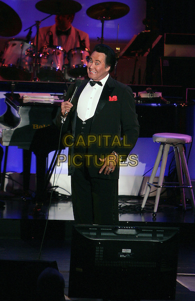 """WAYNE NEWTON.Wayne Newton celebrates his limited engagement, """"Once Before I Go"""", at the Tropicana Resort Hotel and Casino, Las Vegas, Nevada, USA, .28th October 2009..music live on stage singing microphone concert gig tux tuxedo bow tie half length.CAP/ADM/MJT.©MJT/Admedia/Capital Pictures"""