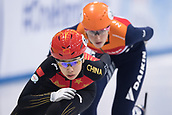 01 February 2019, Saxony, Dresden: Shorttrack: World Cup, quarter finals, 1500 meters women in the EnergieVerbund Arena. Yang Song from China (l) on the track ahead of Suzanne Schulting from the Netherlands.
