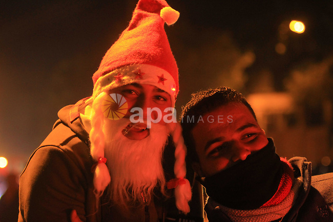 Palestinians celebrate New Year's Eve, in Gaza city, on December 31, 2018. Photo by Mahmoud Ajjour