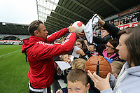 Wednesday, 23 April 2014<br /> Pictured: Lee Trundle signing autographs for supporters.<br /> Re: Swansea City FC are holding an open training session for their supporters at the Liberty Stadium, south Wales,