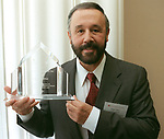 Haliburton Energy Services Group CEO Edgar Ortiz holds his Houston International Executive of the Year award after the awards luncheon at the Houston Club Sept 5,2001. The award is sponsored by the Greater Houston Partnership and the Kiwanis Club of Houston.(Dave Rossman/Special to the Chronicle)  HOUCHRON CAPTION (09/13/2001):  Ortiz.  HOUCHRON CAPTION (09/13/2001):  Halliburton Energy Service Group CEO Edgar Ortiz holds his Houston International Executive of the Year award after the awards luncheon at the Houston Club. The award is sponsored by the Greater Houston Partnership and the Kiwanis Club of Houston.
