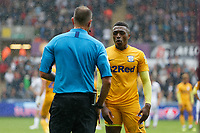 ( L-R ) Referee James Linington speaks to Darnell Fisher of Preston North End before showing him a yellow card during the Sky Bet Championship match between Swansea City and Preston North End at the Liberty Stadium, Swansea, Wales, UK. Saturday 11 August 2018