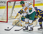 21 February 2015:  University of Vermont Catamount Defenseman Michael Paliotta, a Senior from Westport, CT, misses an opportunity to score in the second period against the Merrimack College Warriors at Gutterson Fieldhouse in Burlington, Vermont. The teams played to a scoreless tie as the Cats wrapped up their Hockey East regular home season. Mandatory Credit: Ed Wolfstein Photo *** RAW (NEF) Image File Available ***