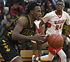 Rashaun Molloy #10 of Wyandanch, left, dribbles downcourt during a Suffolk County League VI varsity boys basketball game against host Amityville High School on Tuesday, Jan. 2, 2018. Amityville won by a score of 95-50.