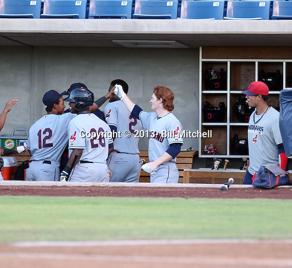 Clint Frazier, Cleveland's 2013 1st round draft choice, hits a homerun in his first professional at-bat for the AZL Indians against the AZL Brewers in the rookie level Arizona League at Maryvale Stadium on June 25, 2013 in Phoenix, Arizona (Bill Mitchell)